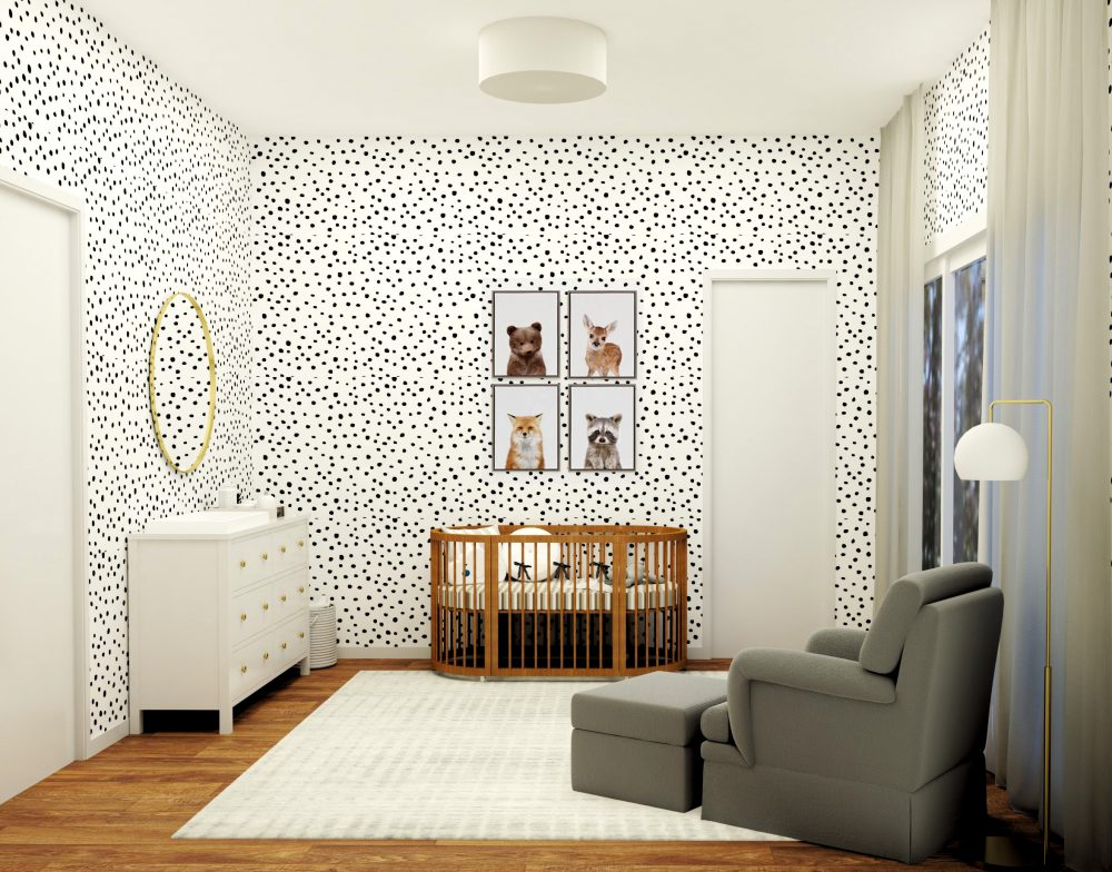 children's nursery with black polka dot wallpaper and pictures of animals hung on the walls